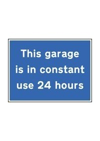 This garage is in constant use 24 hours sign
